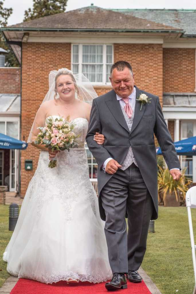 Father walking bride down isle, wedding photographer at Kenwick Park Hotel, Lincolnshire