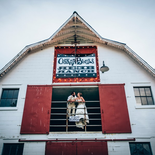 Reeb Ranch Wedding Couple Standing in Barn