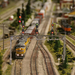 Reed switches in signal moduling in model train track