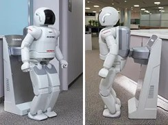 This is how ASIMO charges its battery - ouch...
