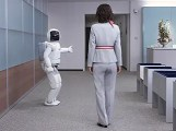 ASIMO gives a visitor directions
