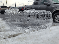 Ice sculpture left in a parking space