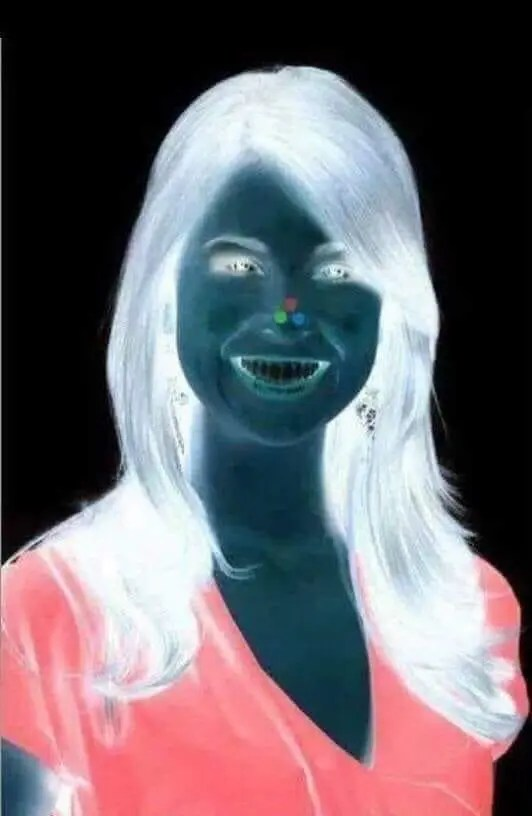 Optical illusion - stare at the red dot for 30 seconds then look at a blank wall