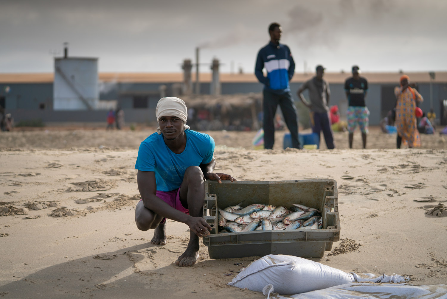 Fisherman showing his catch in The Gambia