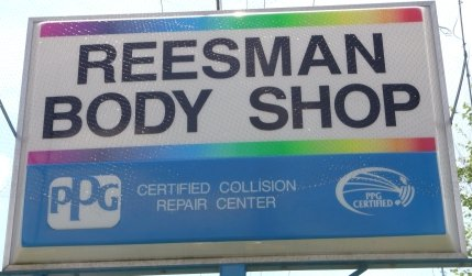Reesman Body Shop Road Sign