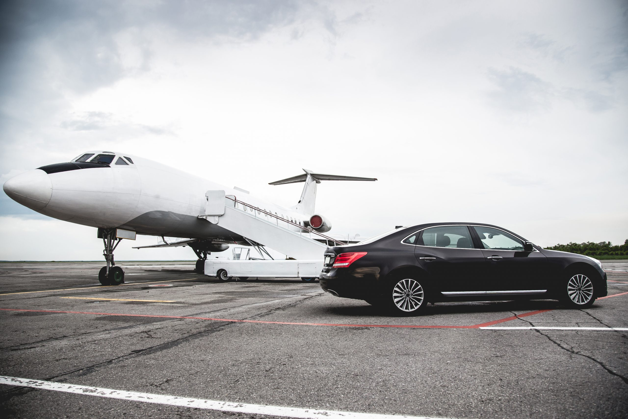 limousine in front a private jet