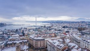 Geneva centre in winter: lake and snowy rooftops