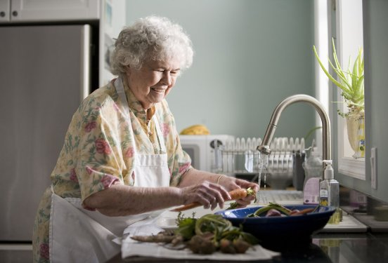 17512-an-elderly-woman-washing-produce-pv