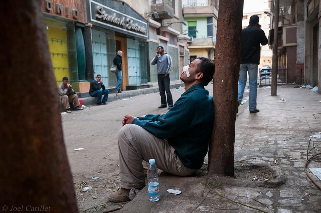 Injured demonstrator in Tahrir Square (Cairo, Egypt - 2 February 2011)