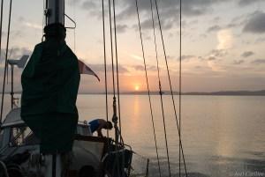 Sunrise and sailboat on Gatun Lake on the Panama Canal