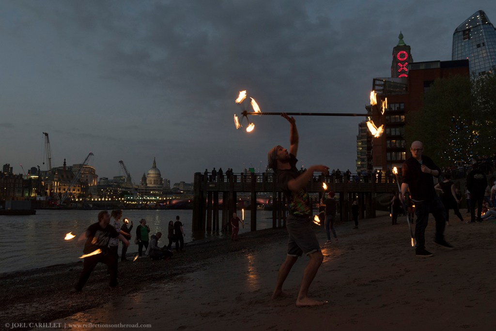 Fire dancing on Thames River in London