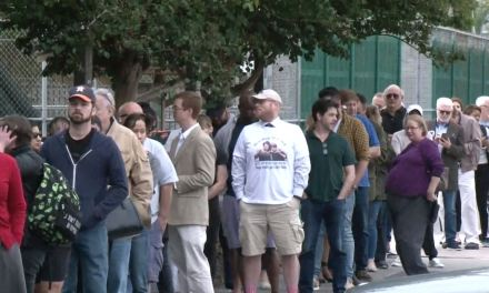 Voters pack lines in Houston on the first day of early voting
