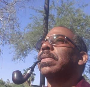 RE Smoking his pipe-cropped