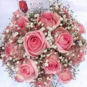 Baby or fuchsia pink roses mixed with gypsophila.