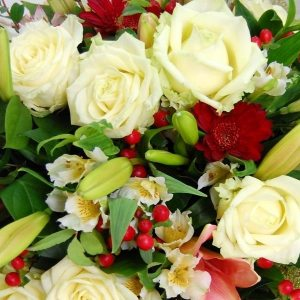 mixture of white roses,white lilies, berries and gerbera