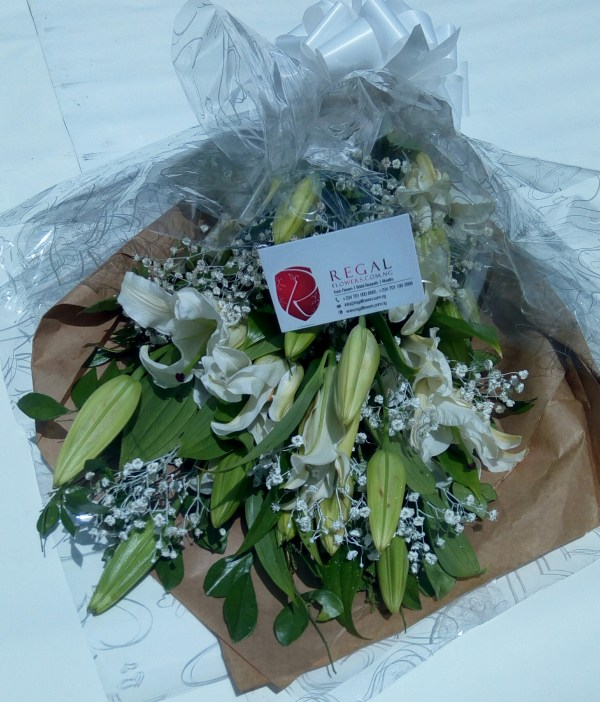 Radiant mix of white Casablanca Lilies nicely arranged with Gypsophila plants.