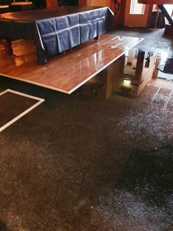 Ravage na de eerste overstroming (aangeleverde foto's café De Bank)