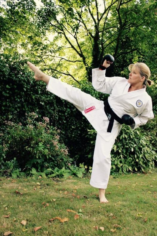a woman throwing karate kicks