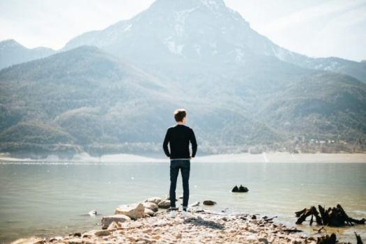 man standing beside a sea