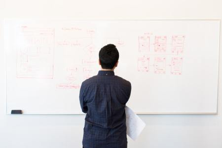 man-standing-infront-of-white-board-1181345