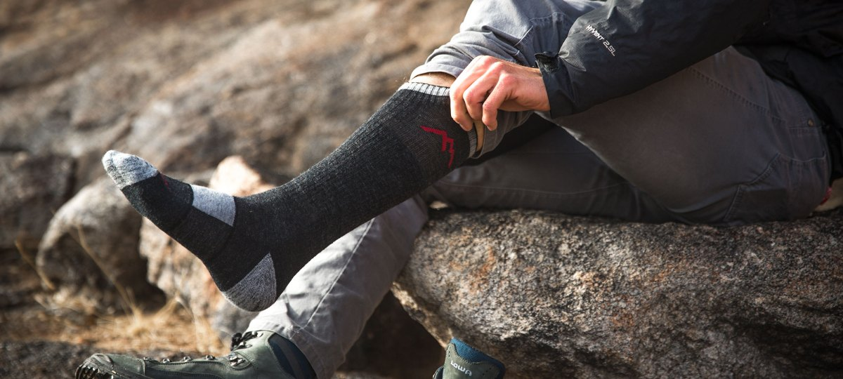 Hiker putting on hiking socks