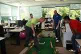 Leah Curulla applies a billiards technique at the Civil Projects themed hole (our Civil group is known for doughnut day)