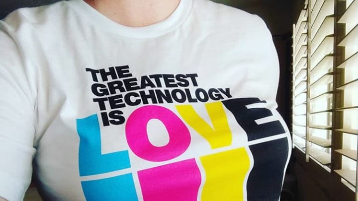 Kyrs Blackwood wearing The Greatest Technology Is Love t-shirt July 2018