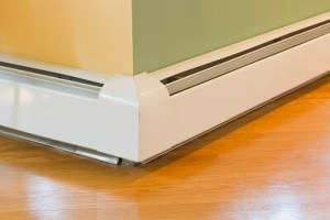 Baseboard heating system along a wall