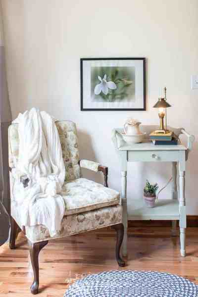 small washstand painted in Miss Mustard Seed Milk Paint Layla's Mint staged with chair and vintage items