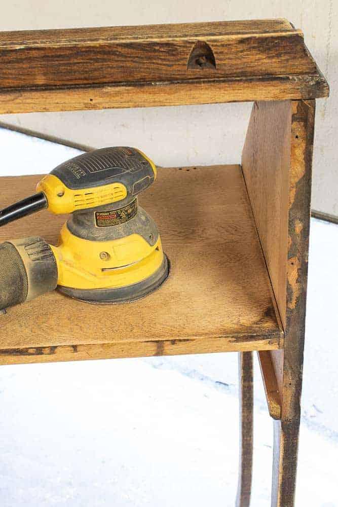 DeWalt orbital sander on top of fold down secretary desk