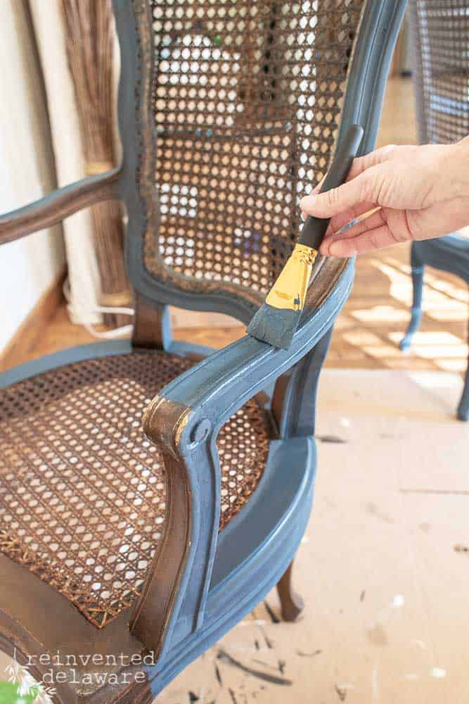 """painting framing on caned chair using a 1 1/2"""" artists brush and Miss Mustard Seed Milk Paint Artissimo"""
