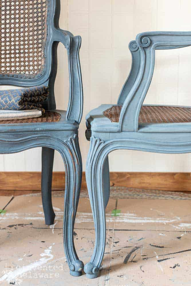close up of painted caned chairs one waxed, one not yet waxed