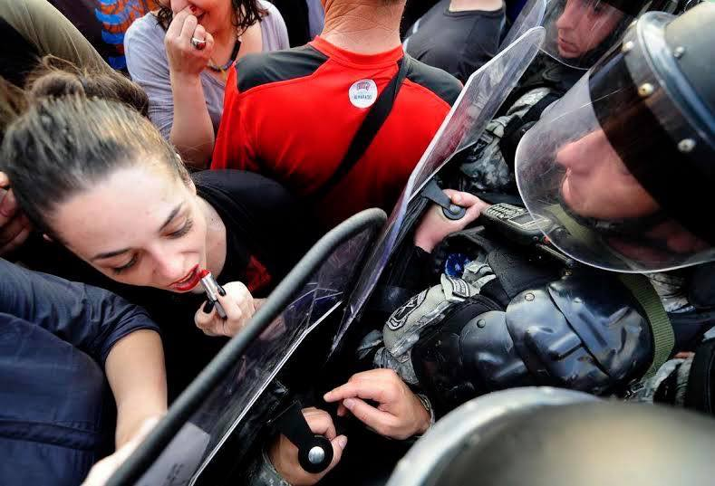 Badass female protestor in Macedonia uses riot shield to