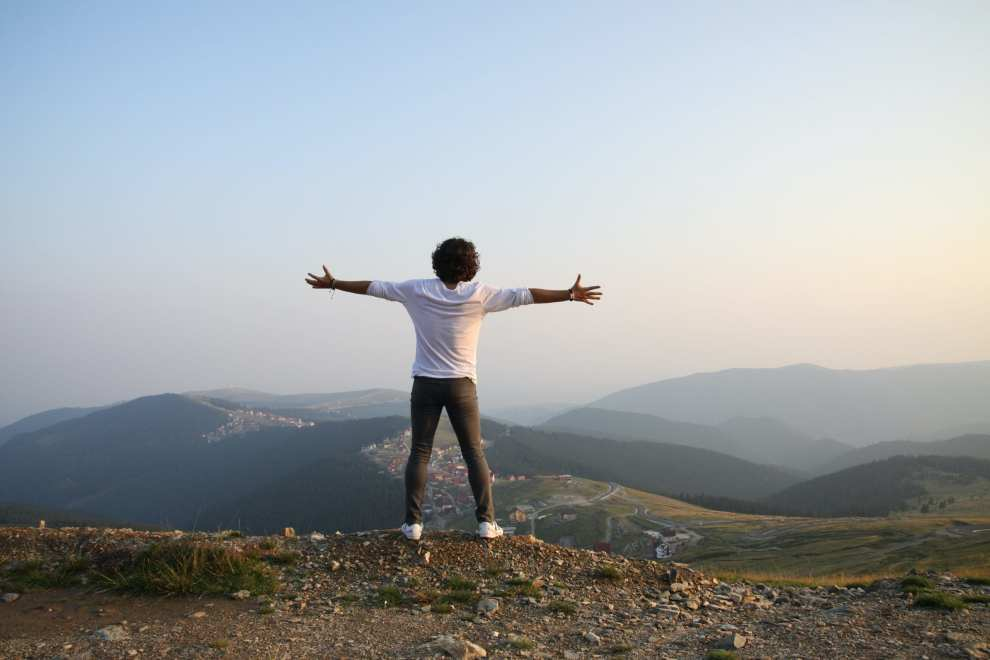 mountain open arms happy man traveling