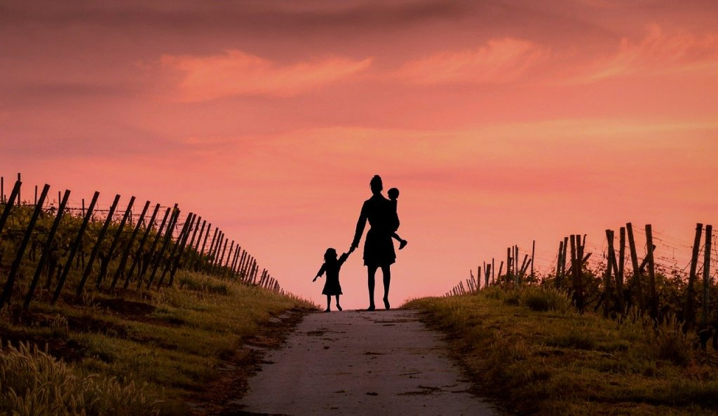 Mother and child, sunset, travelers - travel