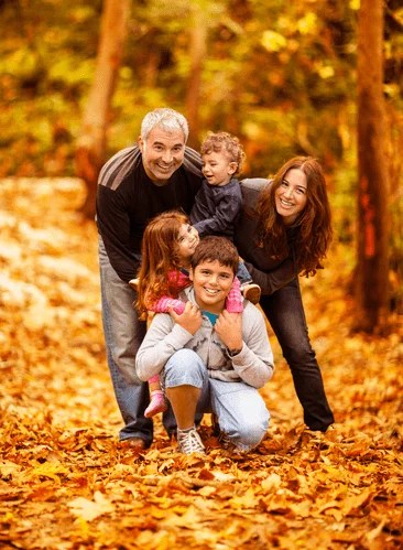 a family outdoors in Autumn