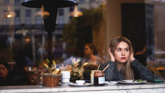 Single Woman sitting alone in cafe