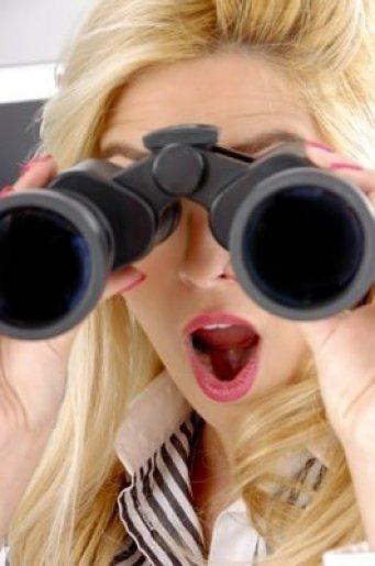 girl watching thorough binoculars