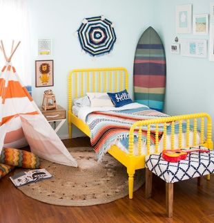 This nursery by 100 Layer Cake-Let is bright and cheery