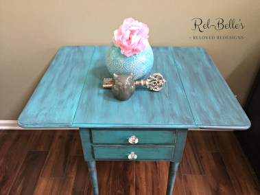 Turquoise table with sides up