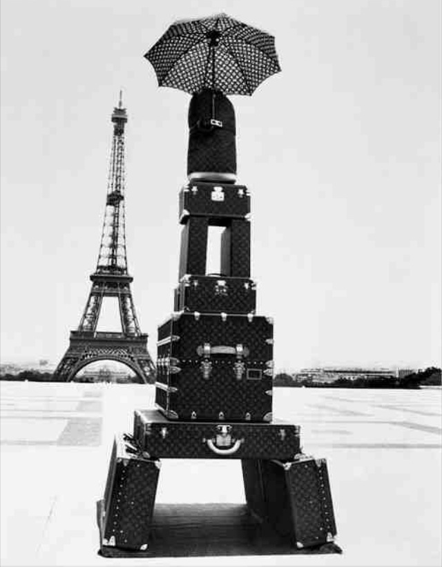 When I write music, I love to get inspired by pictures that tell a story.  This one really caught my eye.  I'm going to Paris in about a month and I can't wait.  I love that the tower in the foreground is made up entirely of louis vuitton luggage.  Shear perfection.