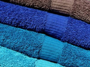 Using towels - one of the eco-friendly ways to use packing supplies.