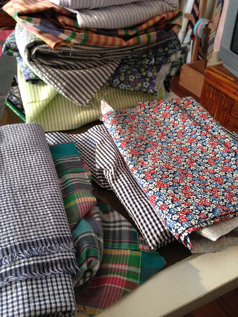 Fabric samples lie at the ready