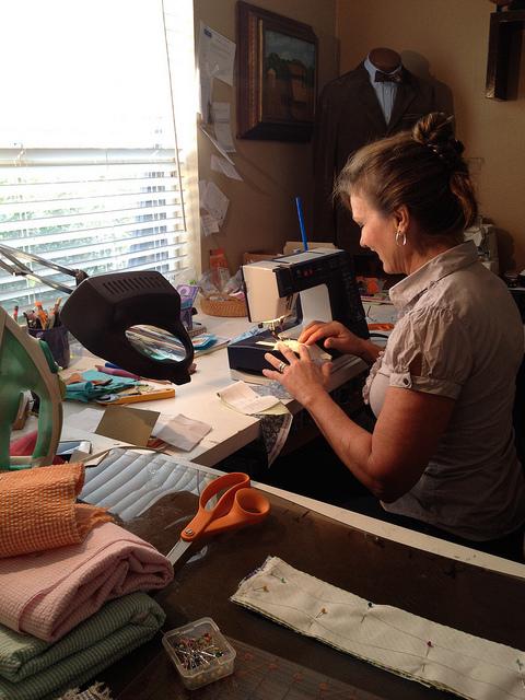 Lisa Kraus assembling a bow tie using 100% silk thread