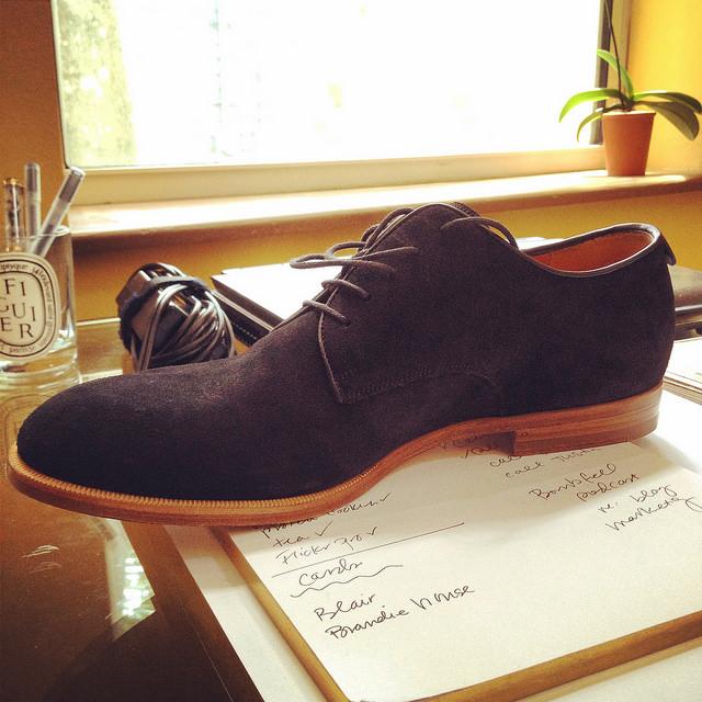 A black suede Gucci buck shoe
