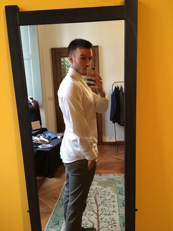 Shirt #1, white with a yellow monogram on the abdomen