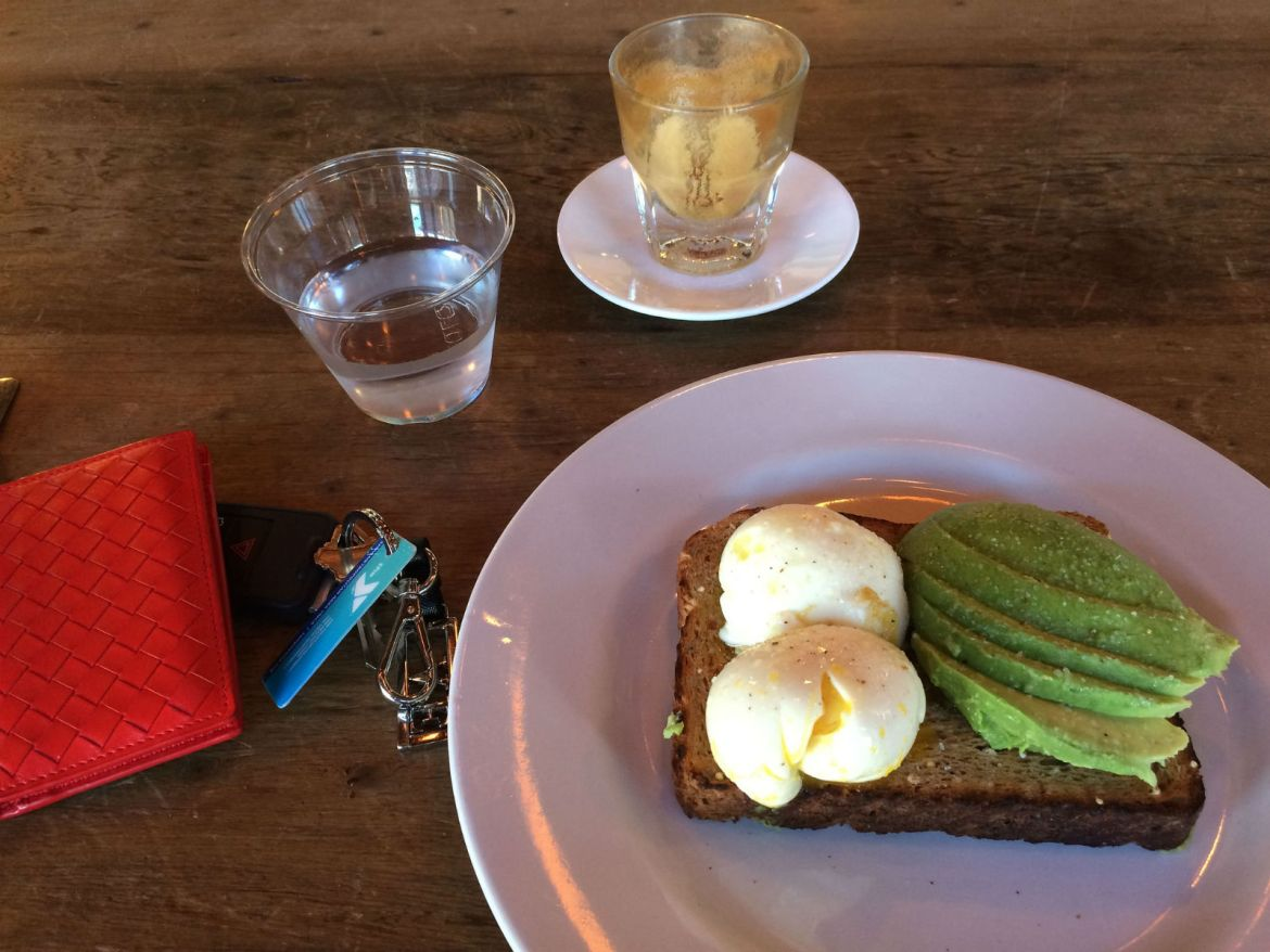 My favorite breakfast in Tampa, the poached eggs and avocado toast at Buddy Brew Coffee