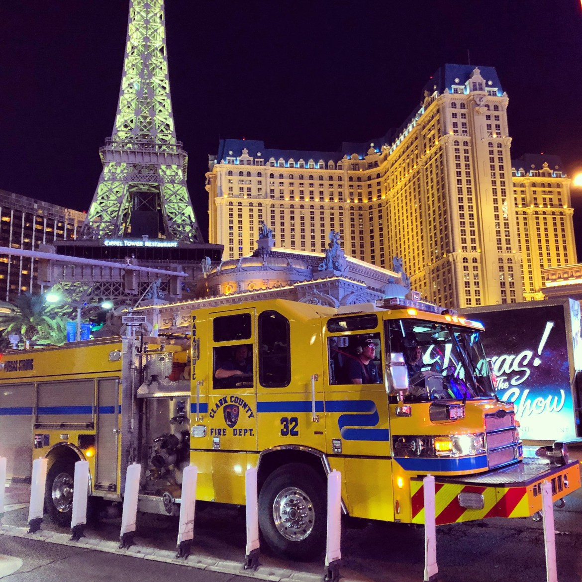 Clark County Engine 32 in yellow on The Strip, in front of Paris Casino