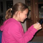 Caitlin Frangel playing nintendo DS