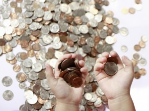 Financial Parenting - Coins In Child Hands
